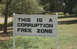 "Photo of a sign which reads ""This is a corruption free zone"""
